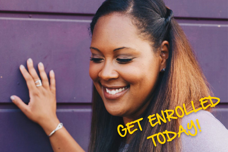black woman standing by a purple wall with words get enrolled today by it