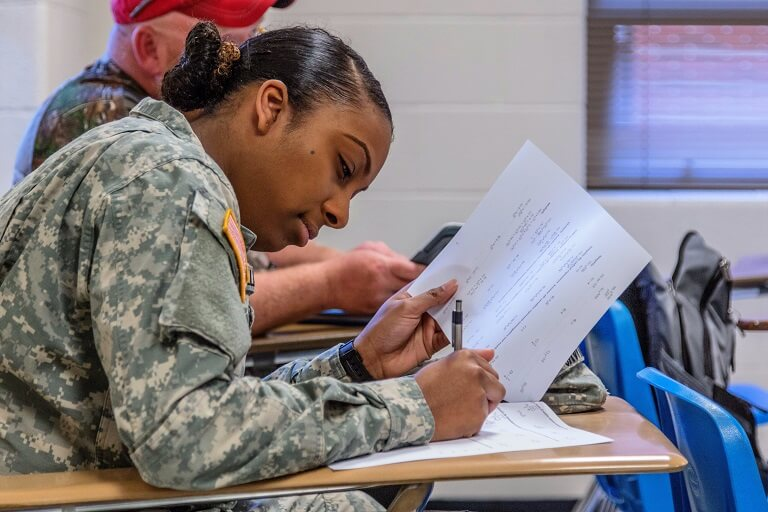 Female soldier sitting in classroom
